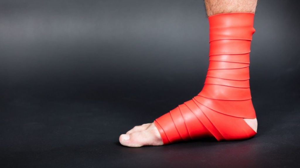 A man's foot wearing very tight foot wrappings