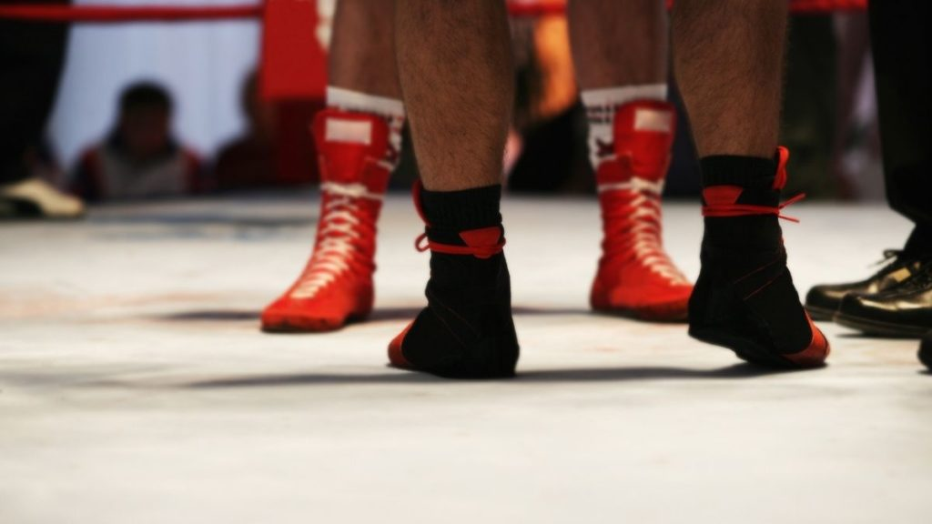 Mixed martial artists wearing different kinds of shoes for fighting